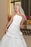 Bride on the mirror. Beautiful blonde bride posing on the mirror Royalty Free Stock Photos