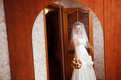 Bride in the mirror Stock Image