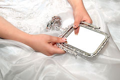 Bride with mirror Stock Image