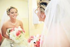 Bride in mirror. Bride smiling in a bathroom mirror Stock Photography