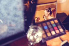 Bride in the mirror wearing make up Royalty Free Stock Photography