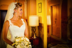 Bride at a mirror Stock Photography