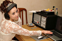 Bride with mixer console. Bride in head-phones with dj's mixer console. Listening to the music Stock Photography