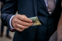 Bride money. Man in suit gives money stock image