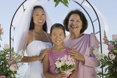 Bride with mother and sister. Outdoors, (portrait Stock Photo