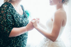 Bride with mother wedding hand. Happy together Royalty Free Stock Image