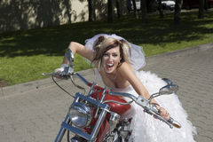 Bride  on  motorcycle Royalty Free Stock Photography