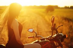 Bride on a motorcycle, royalty free stock photos