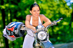Bride on the motorcycle. A just married bride, on the motorcycle stock image