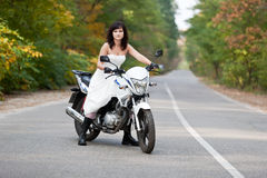 Bride on motorcycle. Royalty Free Stock Images