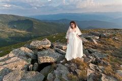 Bride in mountains. Royalty Free Stock Photo