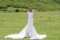 Bride in the mountains. The concept of lifestyle and wedding. Royalty Free Stock Photo