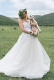 Bride in the mountains. The concept of lifestyle and wedding. Royalty Free Stock Image