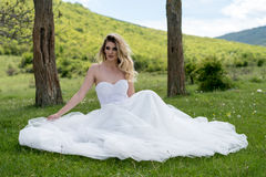 Bride in the mountains. The concept of lifestyle and wedding. Royalty Free Stock Photos