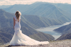 Bride in the mountains. The concept of lifestyle and wedding. Stock Photo