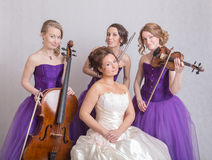 Bride and a musical trio Royalty Free Stock Image