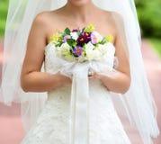 Bride in natural park Stock Photo