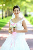 Bride in natural park Royalty Free Stock Images