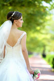 Bride in natural park Royalty Free Stock Photo