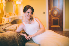 Bride near the bed Royalty Free Stock Image