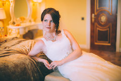 Bride near the bed Stock Photography
