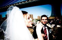 Bride near Brooklyn Bridge. Bride drinking champaigne in Brooklyn stock images