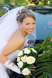 Bride near the car Royalty Free Stock Images