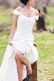 The bride near the cut tree Stock Photo