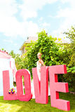 Bride  near the letter the word love, word love composed of letters Royalty Free Stock Photo