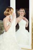 Bride near mirror Stock Photography