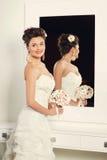 Bride near mirror Royalty Free Stock Photography