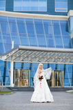 Bride near the modern building Royalty Free Stock Photos