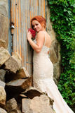 Bride near the old locked door Stock Images