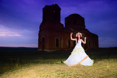 Bride near an old ruined church Stock Photos