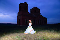 Bride near an old ruined church Royalty Free Stock Photo