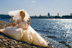 Bride near the River. Portrait of a bride, sitting near the Neva river, Saint-Petersburg Stock Photos