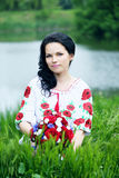 Bride near the river. Beautiful bride in a dress with embroidery in Ukrainian style Stock Photo