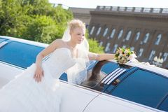 Bride near to the car Royalty Free Stock Photography