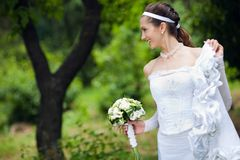 A bride near the tree Royalty Free Stock Photography
