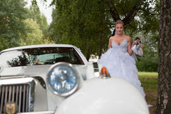 Bride near vintage retro car for wedding Royalty Free Stock Photography