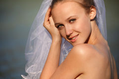 Bride near water line Stock Image