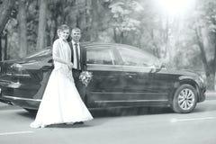 Bride near  wedding car Stock Image