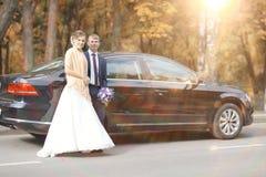 Bride near  wedding car Stock Images