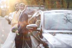Bride near  wedding car Royalty Free Stock Image