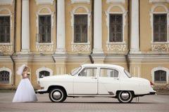 Bride near white vintage car Stock Images