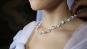 Bride necklace of pearls in a silver frame stock video footage