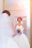 Bride next to mirror Stock Photography