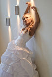 Bride next to the wall Stock Photo