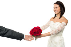 Bride Offering Her Token Of Love To The Groom Stock Photo