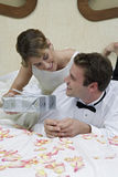 Bride Offering A Present To Her Husband Stock Photos
